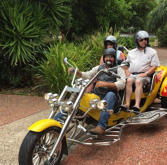 guests riding 3 wheel harley port douglas sunday cruise