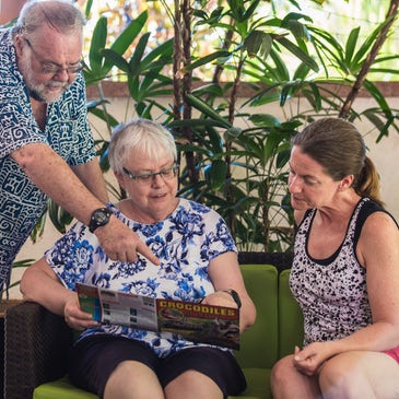 port douglas resort owners doing check-in with a customer